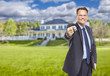 Real Estate Agent with House Keys in Front of Home