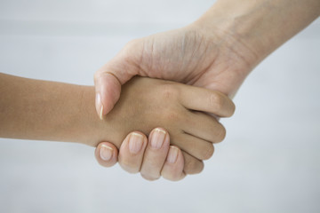 Handshake of mother and son