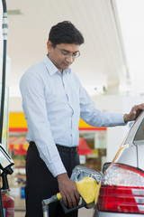 Man pumping gasoline fuel