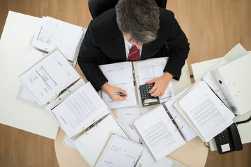 Businessman Calculating Bills