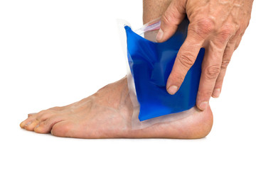 Hand Holding Cool Gel Pack On Ankle