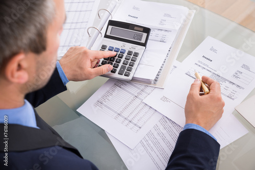 canvas print picture Businessman Doing Calculating