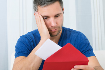 Man Looking At Letter