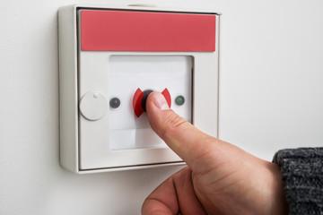 Man Pressing Emergency Button