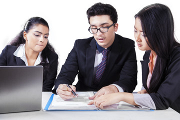 Business group discussing a document