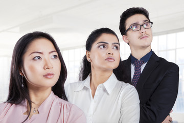 Business team standing in a row at office
