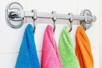 colored towels hanging