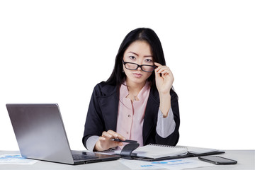 Businesswoman looking at camera through glasses