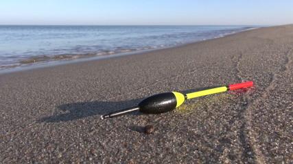 fishing cork float on summer sea resort beach sand