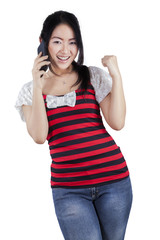 Cheerful chinese girl talking on the phone