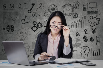 Chinese businesswoman with doodles background