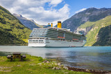 Large luxury cruise ship anchored in fjord