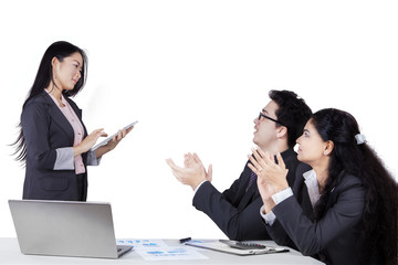 Employees giving applause to their leader