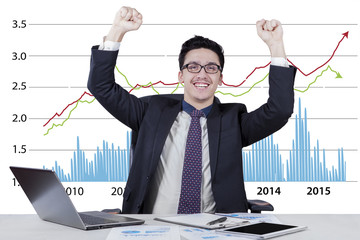 Excited businessman with business growth chart