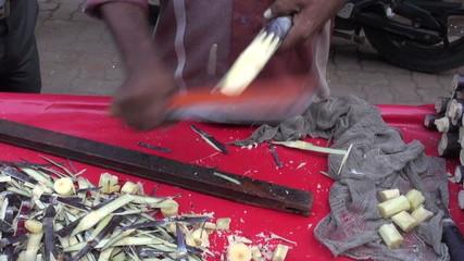 preparing fresh sugarcane pieces in Mumbai market