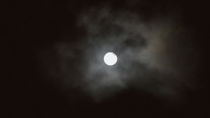 Full moon rising clouds fast