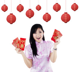 Happy woman with red packet gift