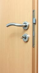 Modren style door handle on natural wooden door.