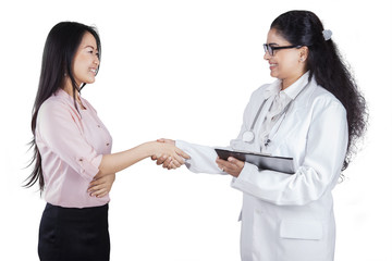 Indian doctor shaking hands with her patient