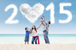 Joyful family under cloud of 2015