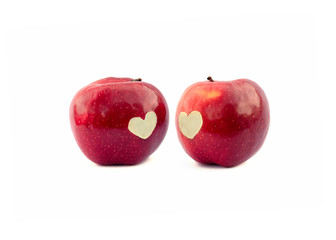two apples with a symbol heart