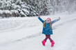 Little girl hamming and playing in the winter forest - 76191077