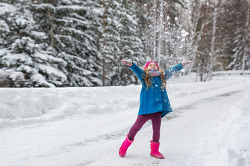 Little Girl throws snow up