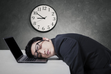 Manager work overtime and sleep on laptop