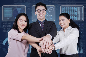 Multicultural businesspeople joined hands