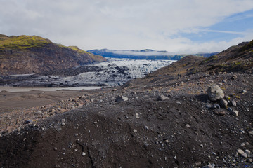 Iceland Glacier with a group of hikers hiking tourists climbing