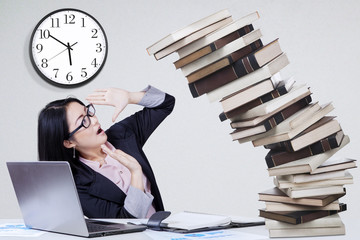 Overworked worker with falling books