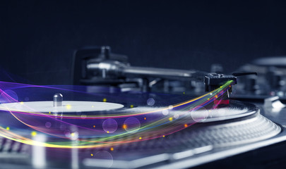 Turntable playing vinyl with glowing abstract lines
