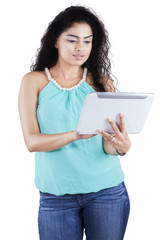 Woman with curly hair using tablet