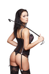 Sexy brunette woman in underwear with whip
