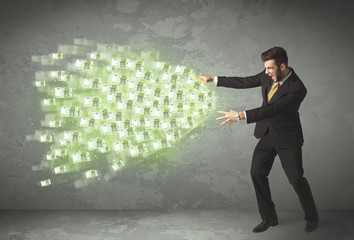 Young business person throwing money concept