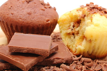 Fresh baked muffins, grated and portion of chocolate