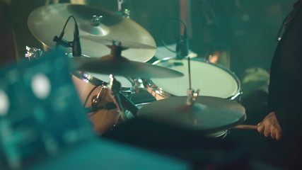 Drummer playing drum set. Close-up