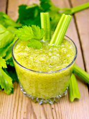 Cocktail with celery in low glassful on board