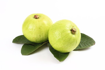 Guavas and leaves on white background