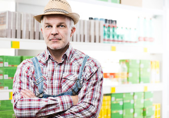 Confident farmer at supermarket
