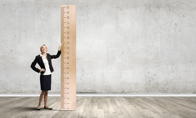 Woman with huge ruler