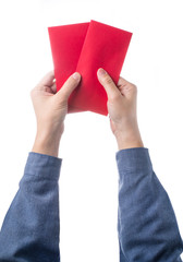 Hand holding chinese red envelope isolated over white background