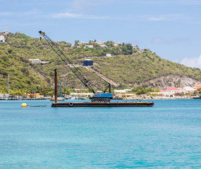 Blue Crane on Barge in Caribbean
