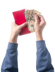 Hand holding chinese red envelope with money isolated