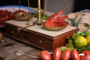 A scale with shrimp and other garnishments