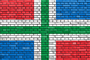 flag of Groningen painted on brick wall