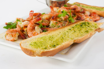 Bread with garlic herb butter and prawns