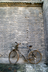 black bicycles standing in the wall