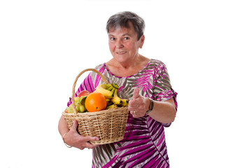 Seniorin mit Obstkorb - Senior woman with basket of fruit