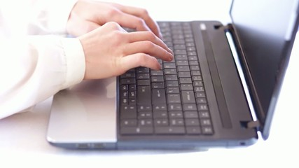 elegant hands typing on laptop computer keyboard